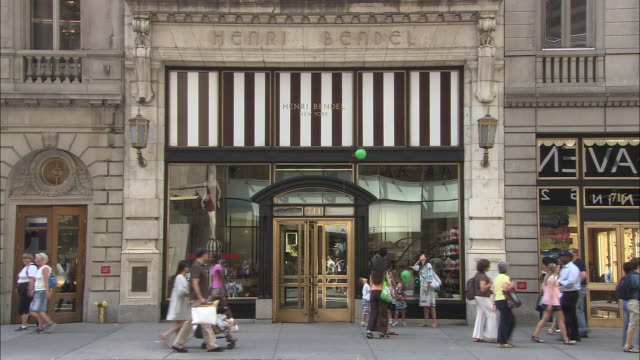 MS, Pedestrians passing by Henri Bendel store, Fifth Avenue, New York City, New York, USA