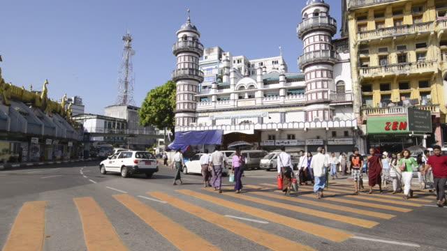 WS Pedestrians waiting at crosswalk to cross street at Bengali Sunni Jamae mosque / Yangon, Yangon Division, Myanmar