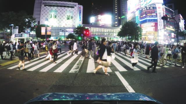Pedestrians walk across Tokyo Shibuya Crossing