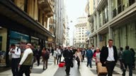Pedestrians walk down a mall in downtowan Buenos Aires on September 30 2014 in Buenos Aires Argentina