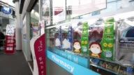 WS pedestrians walk past an airport pharmacy store MS packs of face masks on display at the pharmacy WS a customer walks into a store past packs of...