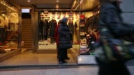 Pedestrians walk past an El Corte Ingles store in Madrid Spain on Wednesday November 12 shoppers walk the high street consumers browse the windows of...