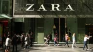 Pedestrians walk past an entrance to the Mid City Center shopping center in Sydney Australia on Thursday April 13 Pedestrians walk past a Microsoft...