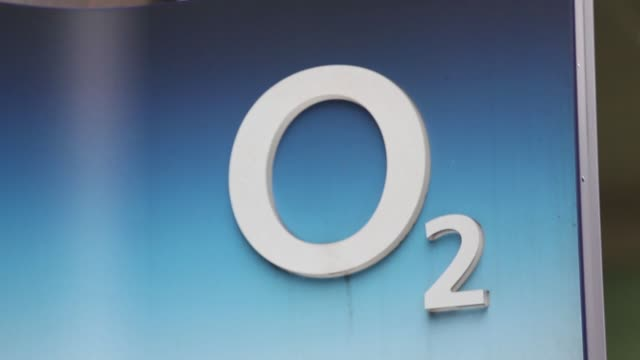 Pedestrians walk past an O2 store in London UK on Wednesday November 26 close up of the O2 logo on a sign gvs of store signage gvs of different...