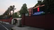 Pedestrians walk past the India Meteorological Department at the Ministry of Earth Sciences complex in New Delhi India on Wednesday July 26 An...