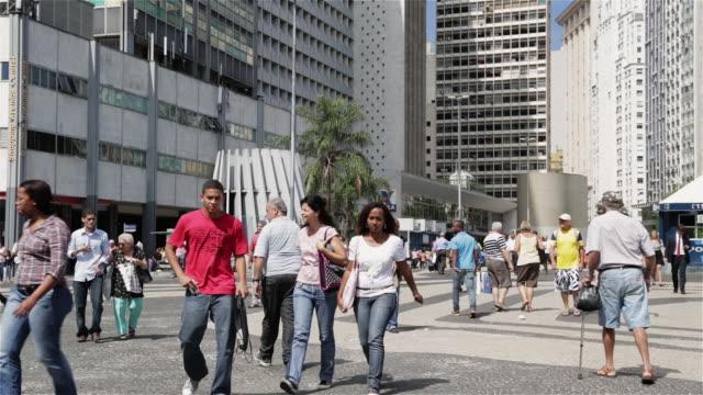 'WS Pedestrians walk through Carioca, downtown Rio de Janeiro / Rio de Janeiro, Brazil'
