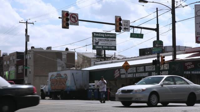 WS Pedestrians walking across 9th Street intersection during rush hour / Philadelphia, Pennsylvania, United States