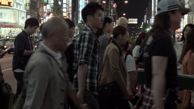Pedestrians walking in Shinjuku, Tokyo, Japan.