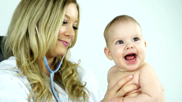 Pediatrician with cute baby girl