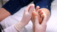 Pediatrist cares for a patient's foot through scrubbing