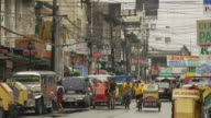 Pedicabs on street in Manila Philippines