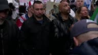 Various shots of Pegida supporters / man wearing Tshirt with slogan 'Enoch Powell Was Right' / placards including 'Trump is Right' 'Nazism =...