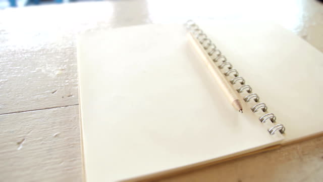 Pencil and Book with blank pages,Dolly Shot
