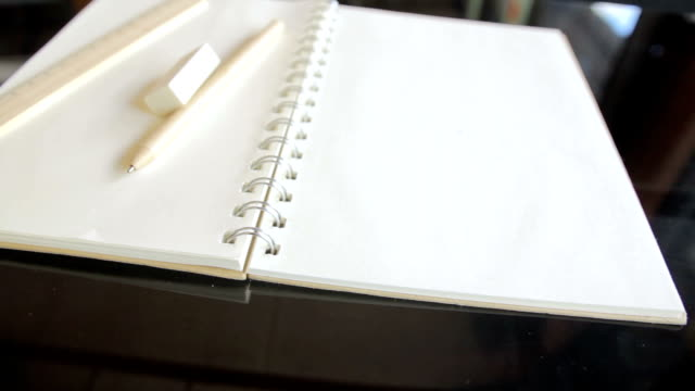 Pencil,Eraser,Ruler and Book with blank pages,Dolly Shot