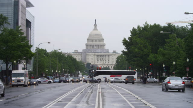 Pennsylvania Avenue traffic on a rainy day, US Capitol in background. Shot in 2012.