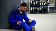 Pensive auto mechanic
