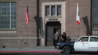 MS TU People and police walking in california city metropolitan police station