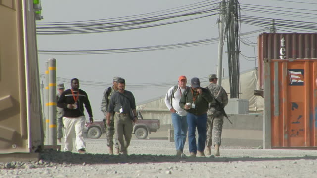 WS People and soldiers walking on street / Musa Qala Helmand Province Afghanistan