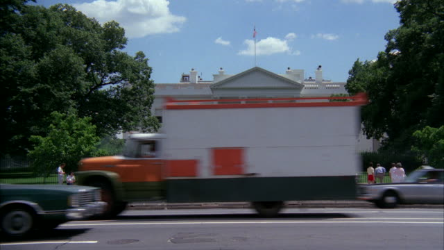 MS People and traffic moving near white house  / Washington DC, United States