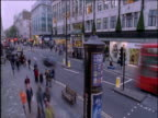 People and traffic stream along Oxford Street London