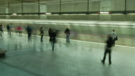 T/L WS PAN People and trains in subway station / Los Angeles, California, USA