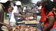 MS People are cooking on bbq pit in downtown / Windhoek, Khomas, Namibia
