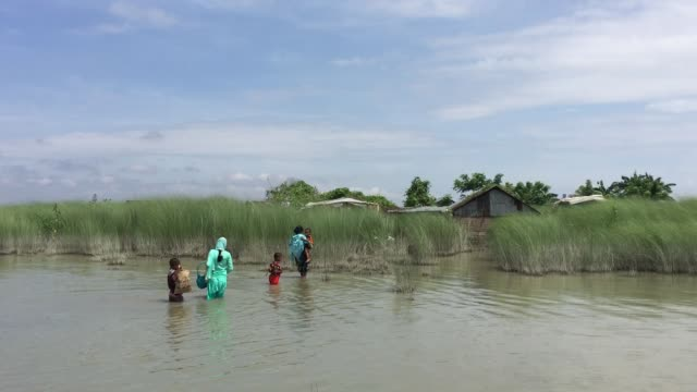 People are returning home in the village which is still affected by flood water in Gaibandha Bangladesh August 19 2017