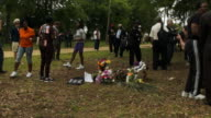 People are seen around the memorial built on the site where Walter Scott was killed by a North Charleston police officer April 12 2015 in North...