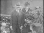 People arrive for launch of Battleship USS Massachusetts / Secretary of Navy William Franklin Knox and Mrs Knox arrive / Mr and Mrs Charles Francis...