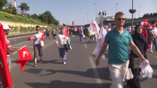 People arrive to attend July 15 Democracy and National Unity Day's events to mark July 15 defeated coup's 1st anniversary at July Martyrs Bridge in...