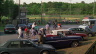WS People arriving for baseball game, walking through parking area