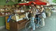 WS People at bakery stall at Viktualienmarkt, Munich, Bavaria, Germany
