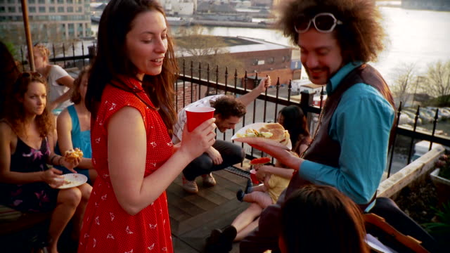 MS People at party on balcony / Brooklyn, New York