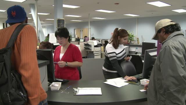 People at reception desk in job center/ Antioch California USA/ AUDIO