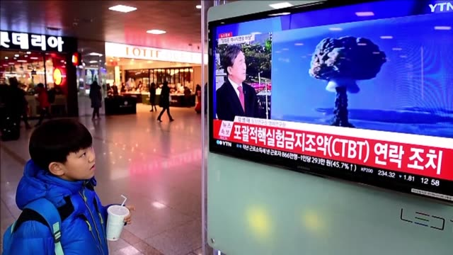 People at Seoul railway station watch the news as North Korea says it has successfully carried out its first hydrogen bomb test