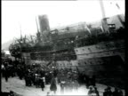 1918 MONTAGE B/W WS PAN People at the Port of Yalta during the arrival of troops from the White Army on board the Saratov ship/ MS PAN Large crowd on board moored ship/ Yalta, Crimea, Ukraine