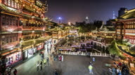 people at Yu Yuan Tea Gardens, illuminated at night