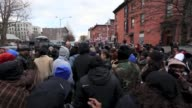 People attend a service with Reverend Al Sharpton and members of the National Action Network during a wreath laying near the site where police...