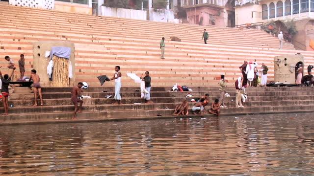 MS POV People bathing at pilgrims near Ganges River / Varanasi, Uttar Pradesh, India