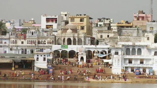 WS People bathing near river shore / Pushkar, Rajasthan, India
