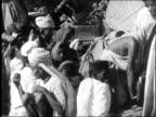 1942 - people bathing, praying in Ganges River
