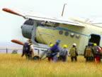 People Boarding on Biplane