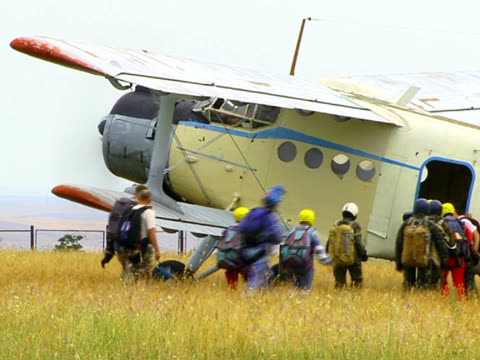 People Boarding on Biplane