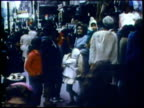 1973 MONTAGE WS People browsing along shops on sidewalk/ WS People on street outside bargain store/ USA/ AUDIO