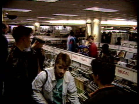 People browsing for records in record store / acid house tshirts / Richard Branson interviewed on October 04 1988 in London says he doesn't think...