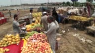 People buying weekly groceries and other household items from weekly Sunday market at Main university road block 7 Gulshan Iqbal in Karachi Pakistan...