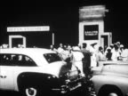 People cabs at port dock w/ Queen Elizabeth sign TU WS People standing along railing on passenger ship MS Cabs at dock TU WS Bow of RMS Queen...