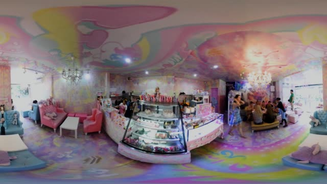 People can eat drink and take photos at the Unicorn Cafe a unicorn and rainbow themed cafe in Bangkok Thailand