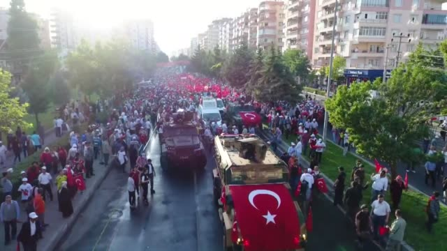 People carry a Turkish flag within the events of July 15 Democracy and National Unity Day to mark July 15 defeated coup's 1st anniversary in...