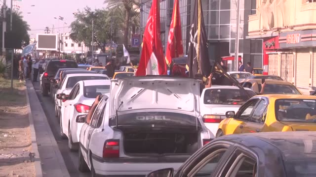 People celebrate with their vehicles after town center of the city has been secured in Kirkuk Iraq on October 16 2017 Iraqi forces on Monday seized...
